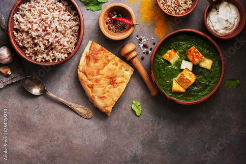 Indian food Palak Paneer , naan bread, rice and spices on a dark background Wallpaper Mural