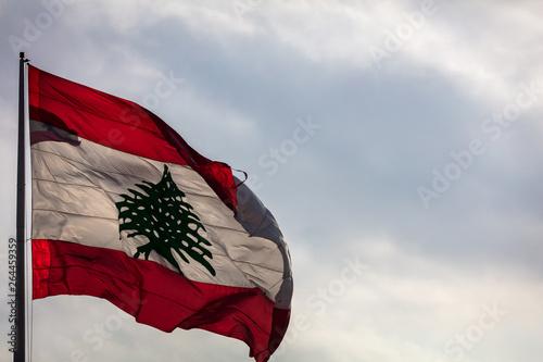 The Lebanese flag flying over Beirut, Lebanon in Spring Fototapeta