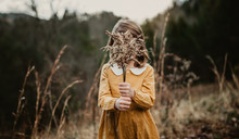 Hides Face Behind Weeds