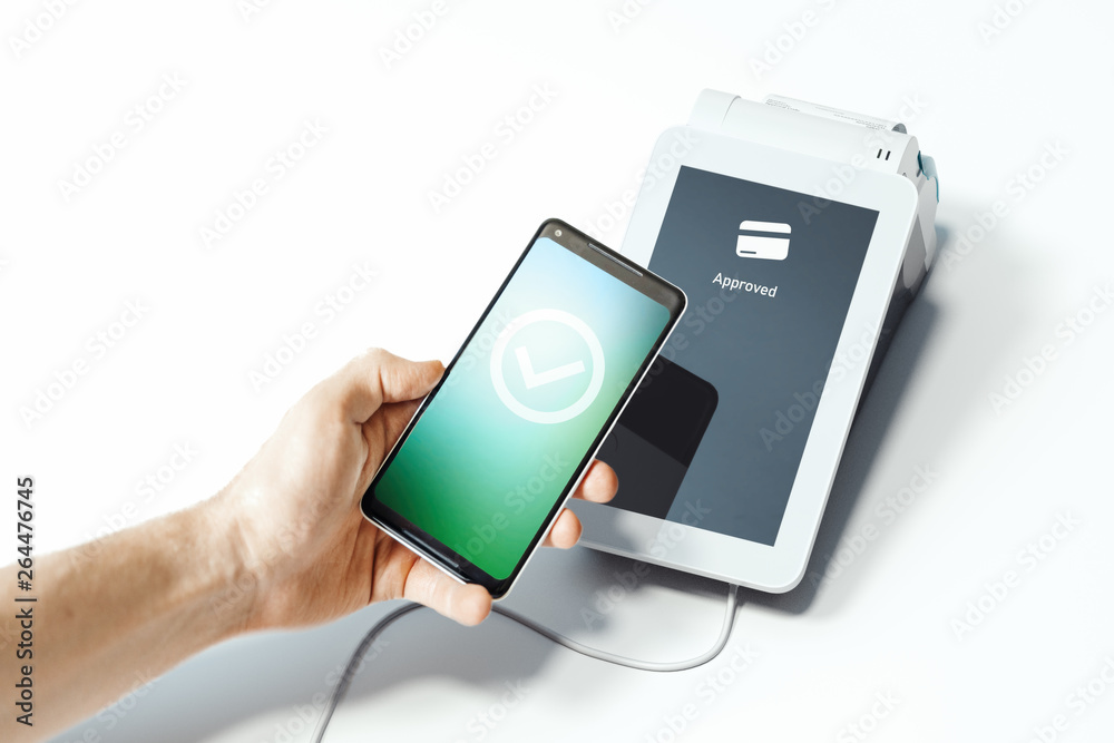 Fototapeta Hand holding mobile phone and POS payment terminal NFC payments. 3d rendering.