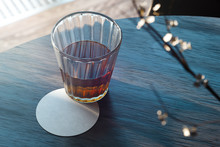 Transparent Glass With Tea And...