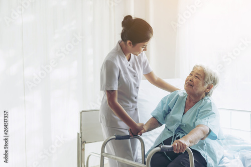 Photo the nurses are well good taken care of elderly patients in hospital bed patients