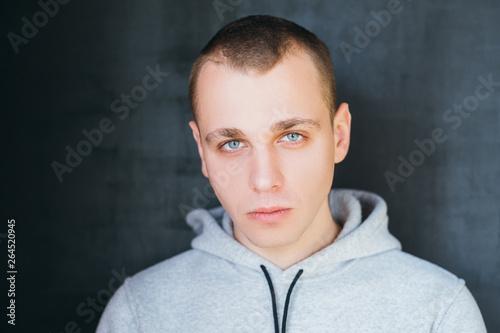 Portrait of handsome insolent guy in hoodie Canvas-taulu