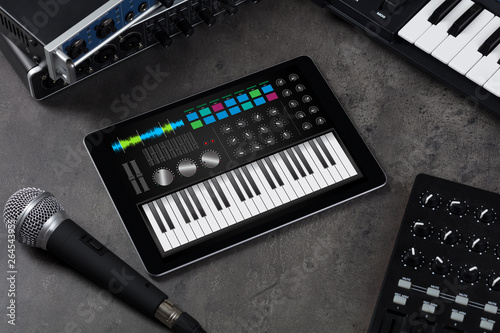 Fototapety, obrazy: Piano synthesizer app on tablet and musical instrument concept