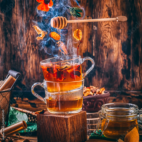 Foto auf AluDibond Tee magic forest tea with smoke and honey dark bright still life