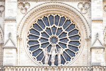 PARIS, NOTRE DAME: The Western Rose Window, And Architectural Details Of The Catholic Cathedral Notre-Dame De Paris. Built In French Gothic Architecture, And It Is Among The Largest And Most Famous