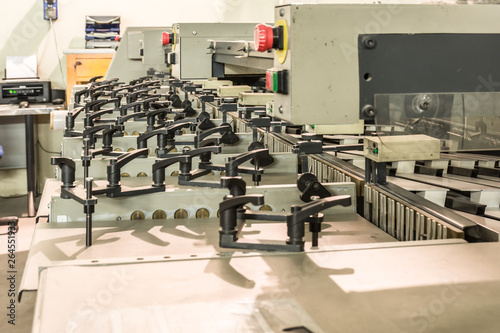 Fotobehang Fitness Paper sheet sorting machine in a printing press