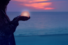 Beautiful Attractive Girl On A Night Beach With Sand And Stars Holds The Moon In Her Hands