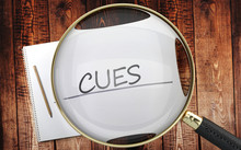Study, Learn And Explore Cues - Pictured As A Magnifying Glass Enlarging Word Cues, Symbolizes Analyzing, Inspecting And Researching The Meaning Of Cues, 3d Illustration