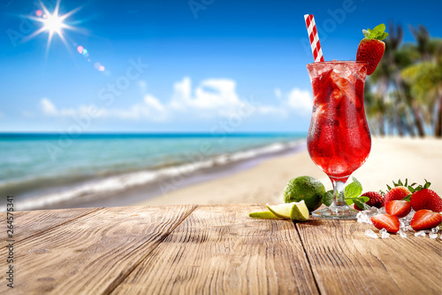 Fresh cold drink on wooden table and free space for your decoration Fototapeta