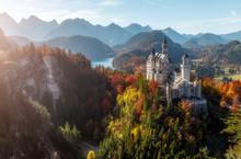 Neuschwanstein Castle Under Sunlight With Mountain Hills On Background,