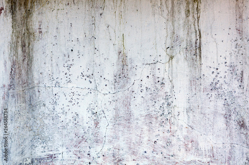 Old whitewashed weathered distressed cracked cement stone wall texture backgroun Fototapeta
