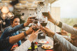 canvas print picture - Young friends celebrating at a dinner at sunset - Detail of hands while toasting with glasses of wine - Happy people at a terrace party after the harvest before sunset - Concept of friendship