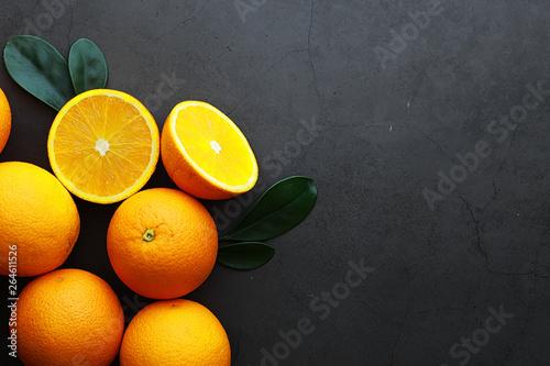 Orange citrus fruit on a stone table. Orange background. - 264611526