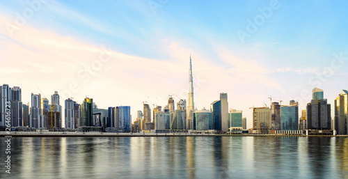 Foto op Aluminium Shanghai Stunning panoramic view of the Dubai skyline during sunset with the magnificent Burj Khalifa and many other buildings and skyscrapers reflected on a silky smooth water. Dubai, United Arab Emirates.