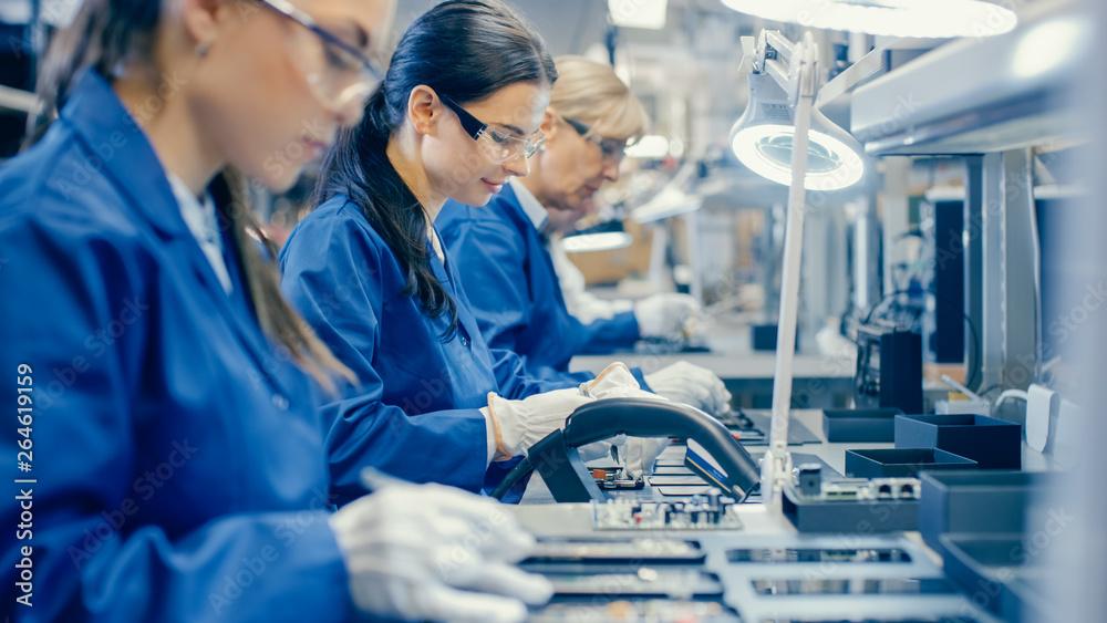 Fototapeta Women working in electronics factory