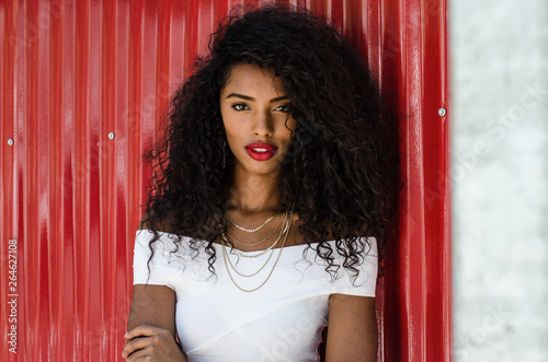 Black woman with red lips looking at camera