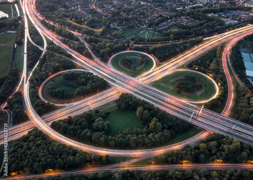 Aerial long exposure of highway node with overpasses and curves illuminated by c Canvas Print