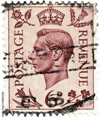 Vintage stamp printed in Great Britain 1937 shows , King George VI Canvas-taulu