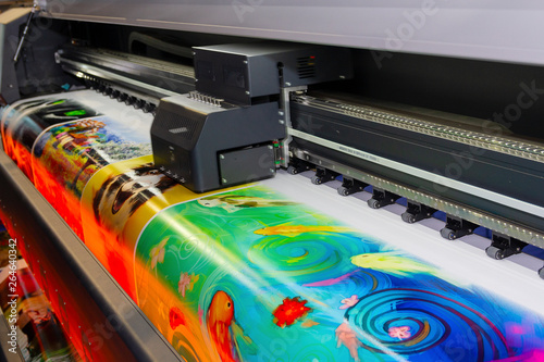 Large format printing machine in operation. Industry Fototapet