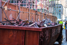 Old Rusty Dumpster On A City Street Construction Site