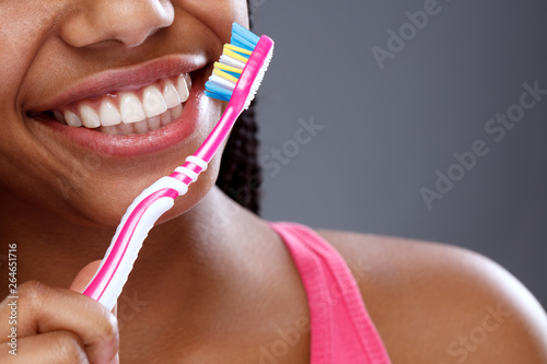 Fotografía Oral hygiene with toothbrush in girl's hand, close up