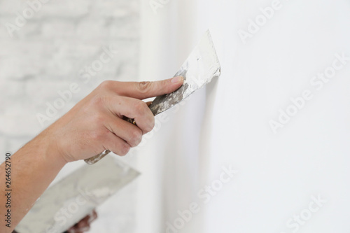 Fotomural Plastering wall with putty-knife, close up image