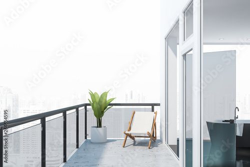 Fototapeta  Balcony with city view and black marble bathroom