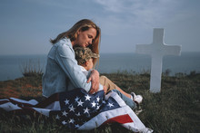 Mother With Son In The Cemetery Near The Grave Of The Father Of The American Soldier Who Died In The Ridge Point Defending The Sovereignty And Independence Of The United States Of America