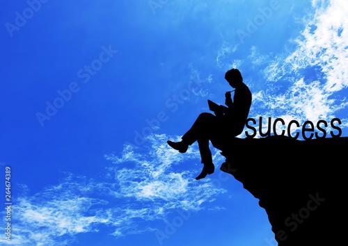 岩に座って勉強する男性のシルエット Billede på lærred