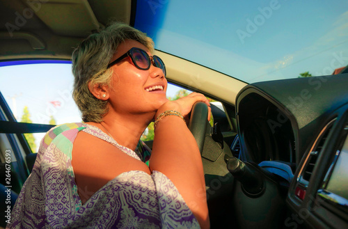 Photo  lifestyle Summer portrait of middle aged happy and attractive classy Asian Indon