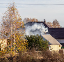 Smoke From The Chimney On The Roof Of The House