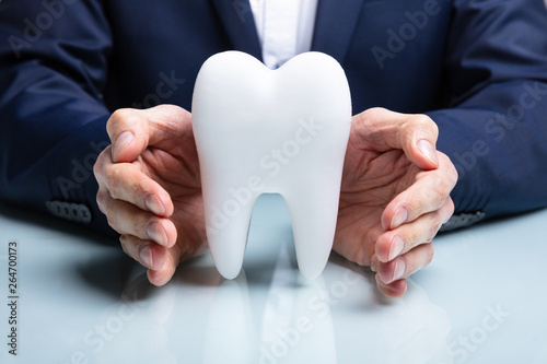 Fototapety, obrazy: Man's Hand Protecting White Tooth