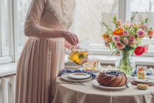 Tea Time, Woman Hands Holding Tea Pot, Flowers And Cake