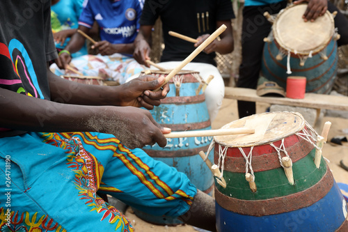 Close-up of a musician playing traditional drums on the beach in Accra, Ghana - 264718190