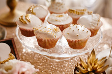 Delicious Wedding Cupcakes With Glaze With Gold Details At The Wedding Buffet