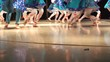 Closeup of female legs of dancers moving on dancing floor of stage.