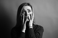Portrait Of Scared Young Woman. Black And White