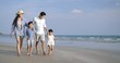 Happy asian family enjoying and walking down the beach on summer vacation. Slow motion. Family, Holiday and Travel concept.