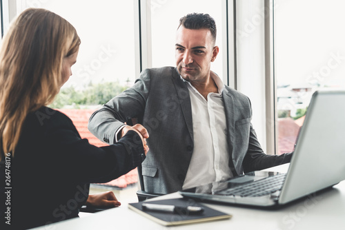 Garden Poster Businessman executive handshake with businesswoman worker in modern workplace office. People corporate business deals concept.
