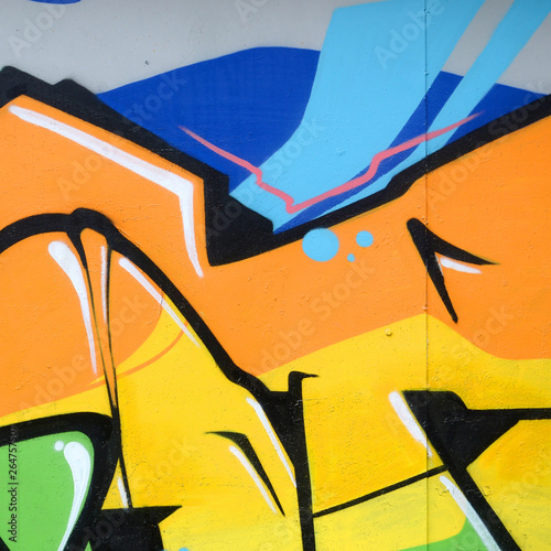 Fragment of colored street art graffiti paintings with contours and shading close up © mehaniq41
