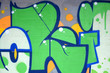 Leinwanddruck Bild - Fragment of colored street art graffiti paintings with contours and shading close up
