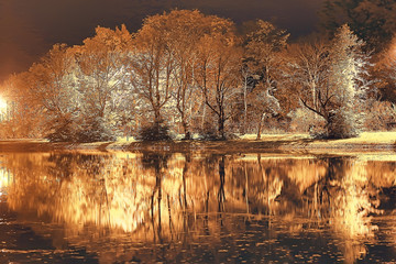 Fototapeta Optyczne powiększenie night autumn park landscape / beautiful night in a city park with yellow trees
