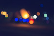 Vintage tone abstract blur image at night with bokeh for background use. Bokeh light and background blurred.