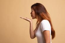 Beautiful Young Asian Woman Blow A Kiss.