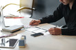 Designer man creative drawing website ux app development and application for mobile phone in the office.