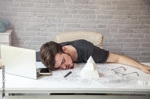 Fotografie, Obraz  Man designers sleeping because of fatigue from work.