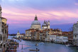 Beautiful view on Basilica di Santa Maria della Salute in golden evening light at sunset in Venice, Italy