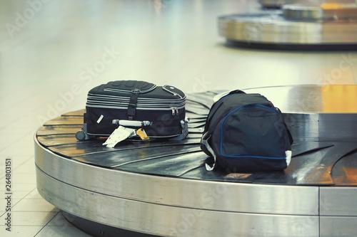 Fototapeta  Baggage on conveyor belt at the airport