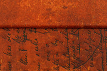 Structure Of An Old Cover Of Books Of Red Color With Time Marks In The Form Of A Scratching, Scratches, Spots. Ancient Ornament And The Cut-out Details Repeatedly Were Restored. Ready Photo Background